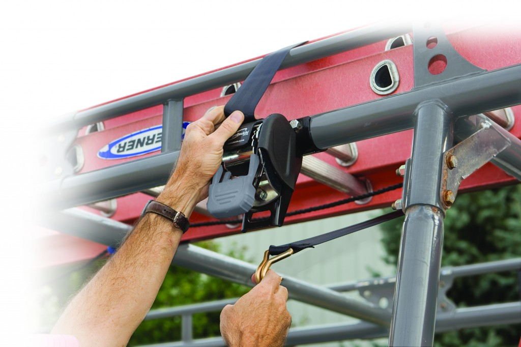 CargoBuckle ladder rack tie-down system shown mounted and securing a ladder on a vehicle.